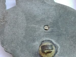 Two piece construction rivet reverse of globe