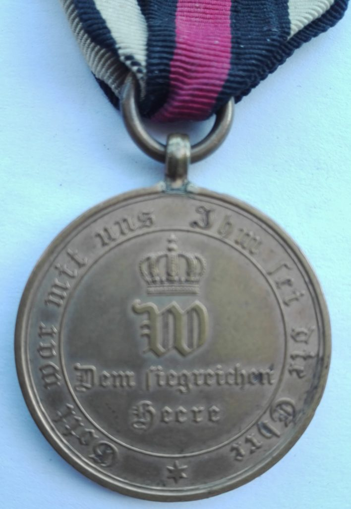 Close up of the reverse of the medal