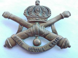 Unknown artillery badge. Crossed cannons, crwon and made of brass