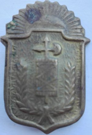 Brass badge front