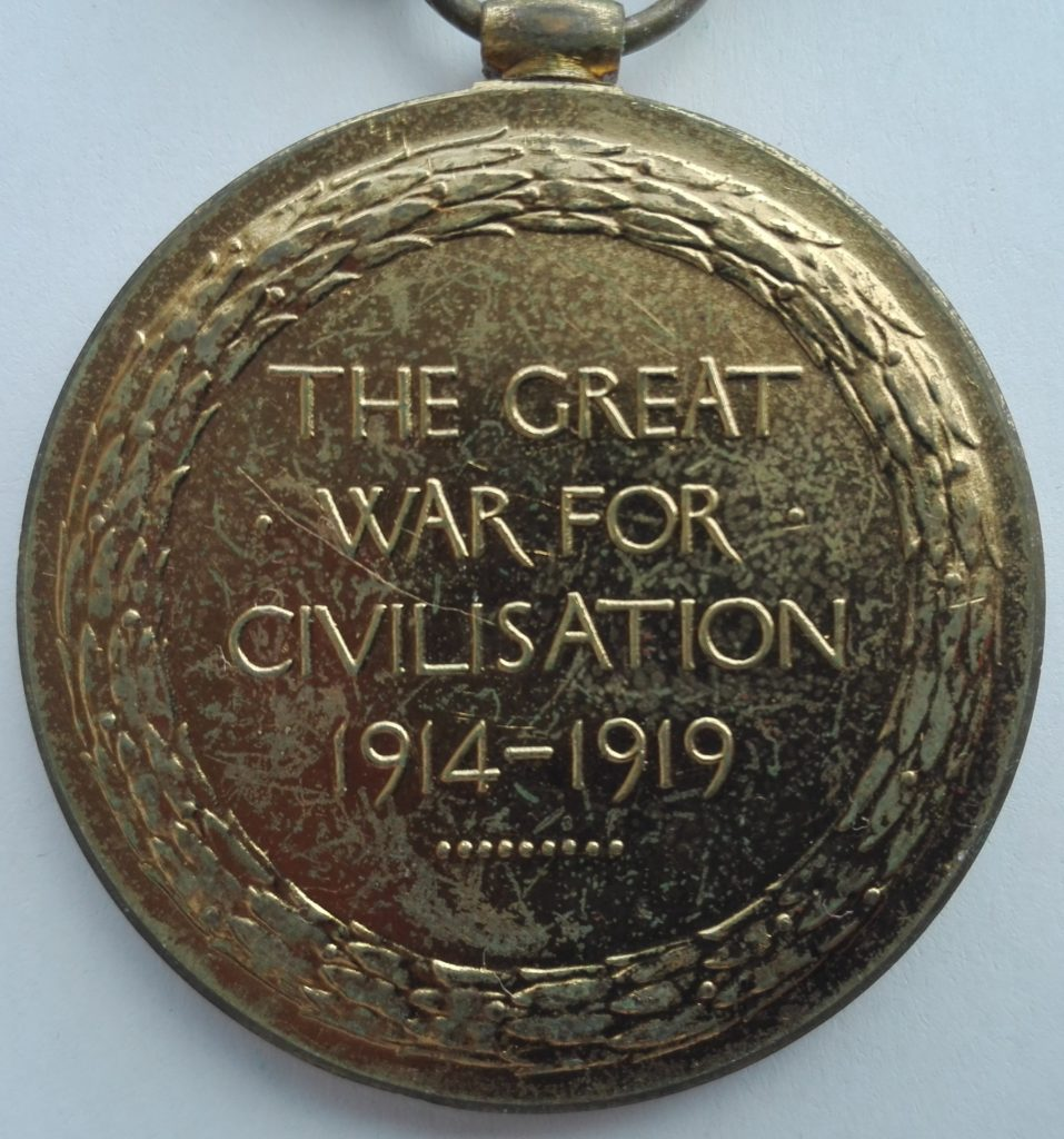 Reverse of the medal with the standard raised lettering commemorating the great war.