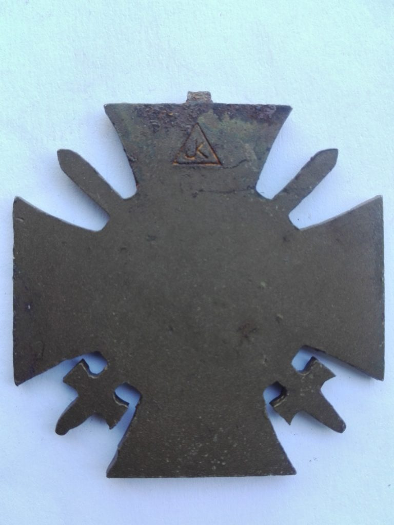 Germany frontfighters  cross with swords maker marked JK in Triangle and the J and K sharing the vertical indentation.
