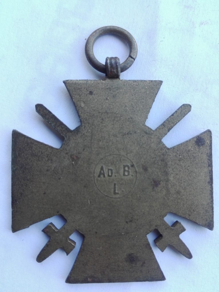 Reverse of First world war German medal for War service with swords. Maker on back states AD. B. L.