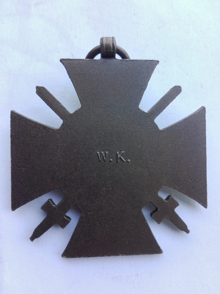 Rear of W.K. marked in relief First world war German medal for War service with swords.