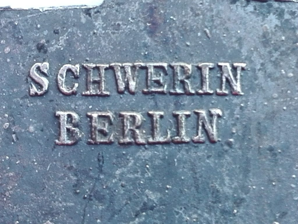 "Manufacturer marking ""Schwerin Berlin"" in block capitals and relief on the reverse of the badge."